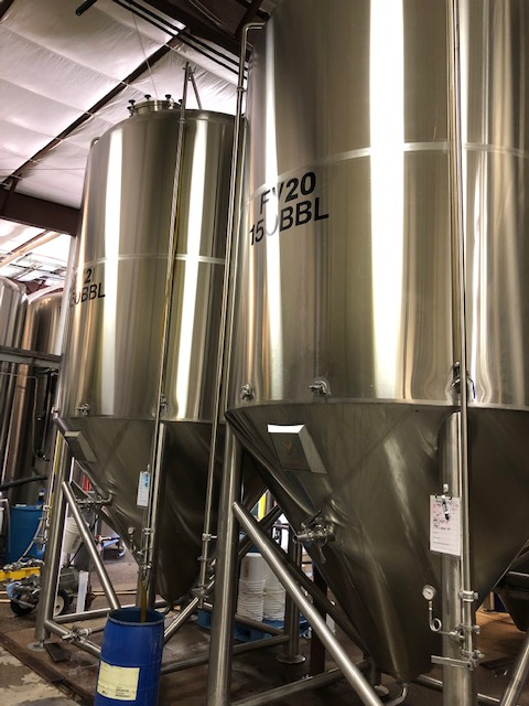 MARKS stainless steel tanks brewing cider and hard seltzer.
