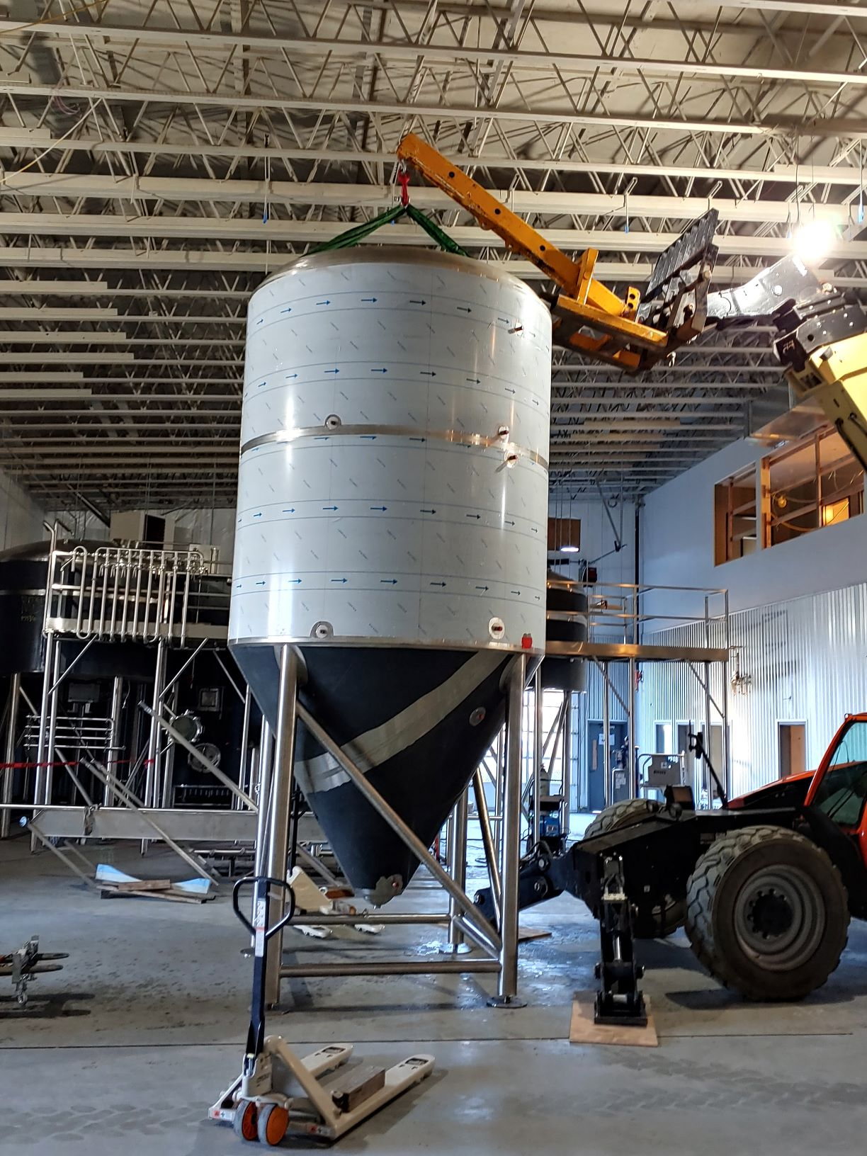 MARKS setting up new equipment for a new brewery.