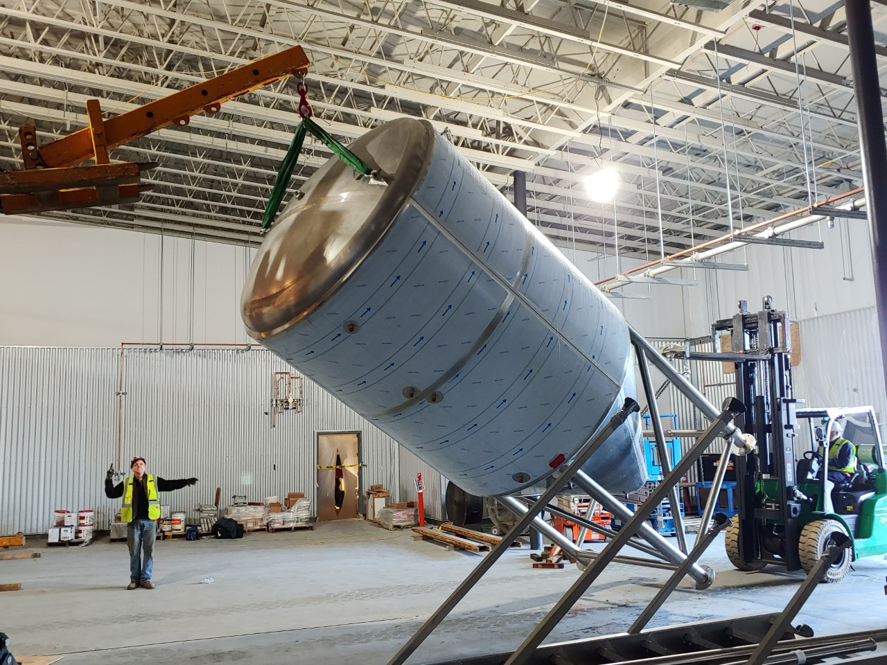 MARKS' crew raising a new brew tank in a brewery.